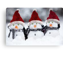 Snowmen with Christmas hats Canvas Print