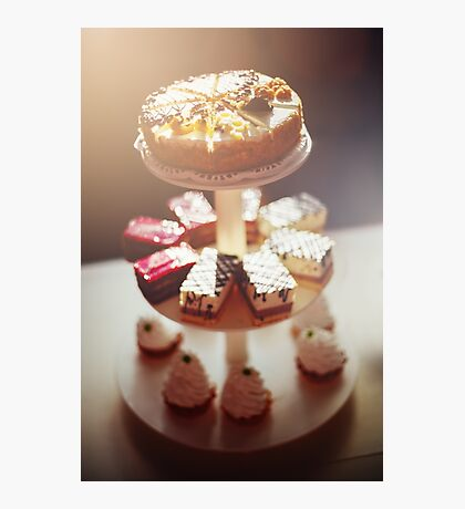 Blurred image of different tasty cakes Photographic Print