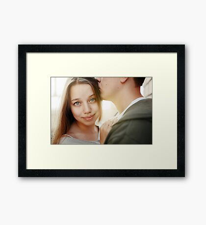 Sunny outdoor close up portrait of young pretty stylish couple Framed Print