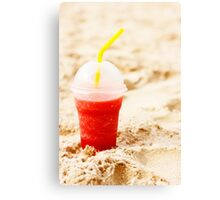 Red fruit icy cocktail in beach sand Canvas Print