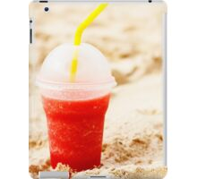 Red fruit icy cocktail in beach sand iPad Case/Skin
