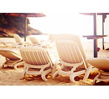 Row of beach chairs on the sea Photographic Print