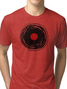 Spinning within with a vinyl record... Tri-blend T-Shirt