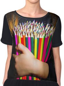 Cute little girl with colorful pencils, on yellow-green background Chiffon Top
