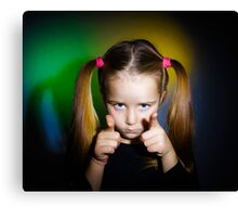 Cute little girl showing to you by fingers, on yellow-green background Canvas Print