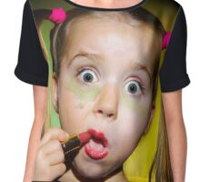 Funny little girl making make-up by herself, on colorful background Chiffon Top