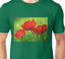 red tulips on green background Unisex T-Shirt