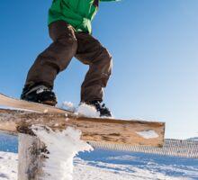 Snowboarder sliding on a rail Sticker