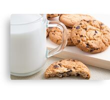 Glass cup with milk and oatmeal cookies with chocolate Canvas Print