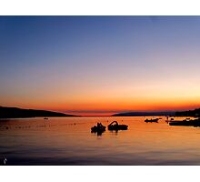 Two pedal boats in the sunset Photographic Print