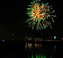 Green fireworks over the river by Tino161