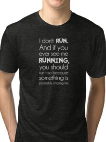 I Don't Run.  Something Is Probably Chasing Me. Tri-blend T-Shirt