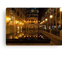 Elegant Symmetry - Reflections in Gold and Black Canvas Print