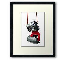 camera in red-black case Framed Print