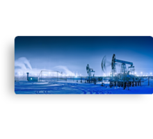 Winter night panoramic oil pumpjack. Canvas Print