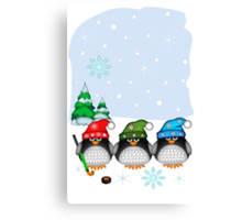 Hockey Penguins with snowflakes hats in a snowy landscape Canvas Print