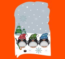 Hockey Penguins with snowflakes hats in a snowy landscape Kids Tee