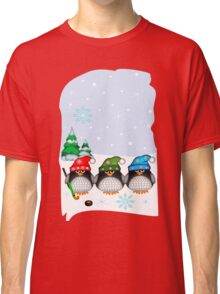 Hockey Penguins with snowflakes hats in a snowy landscape Classic T-Shirt