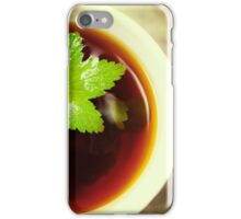 Herbal tea close up with green leaf iPhone Case/Skin