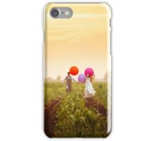 Young wedding couple running on the sunset field iPhone Case/Skin