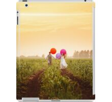 Young wedding couple running on the sunset field iPad Case/Skin
