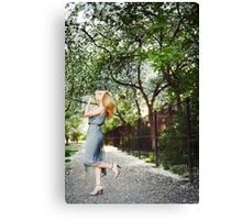 Young blonde womanl dancing on the road Canvas Print