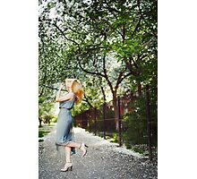 Young blonde womanl dancing on the road Photographic Print