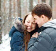 Couple in love having fun in winter forest Sticker