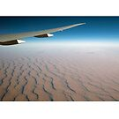Airliner wing over the Afghani Desert by stuwdamdorp