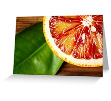 Blood orange fruit close up on wooden table Greeting Card