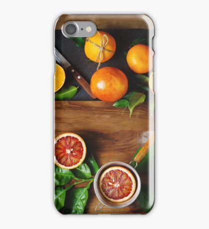 Different sort of orange fruit on wooden iPhone Case/Skin