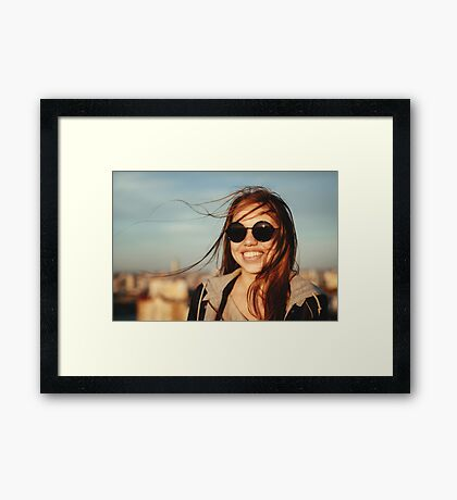 Young woman in round sunglasses having fun Framed Print