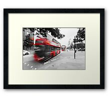Red double-decker bus on the street of London Framed Print