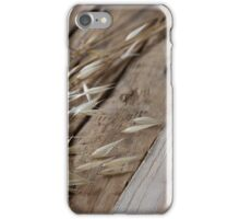 Delicate dry wild plants in beige on wood background, rustic  iPhone Case/Skin