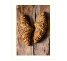 Whole wheat croissants with sesame seeds on rustic wood table top view Art Print