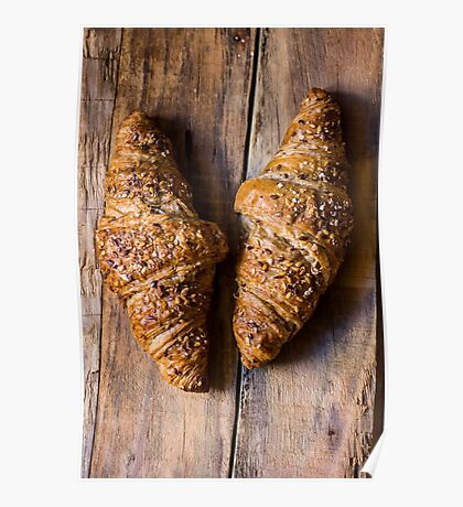 Whole wheat croissants with sesame seeds on rustic wood table top view Poster