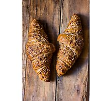 Whole wheat croissants with sesame seeds on rustic wood table top view Photographic Print