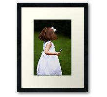 A child and technology Framed Print