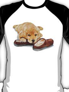 cute puppy golden retriever cuddling slippers T-Shirt