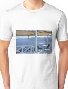 Table and chairs by the sea in Santorini,Greece Unisex T-Shirt