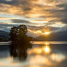 Sun dissapears behind Ben Lawers, Perthshire, Scotland by Cliff Williams