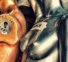 Bronze and silver female mannequins in storage. Sticker