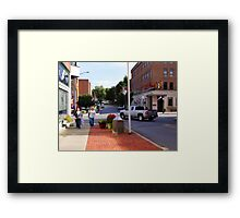 A city street scene Framed Print