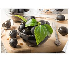 Black olives in glass cups with oil Poster