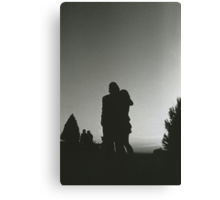 Wedding guests walking holding in silhouette at sunset in marriage party silver gelatin black and white 35mm negative analog film photo  Canvas Print