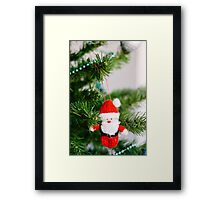 knitted santa Framed Print