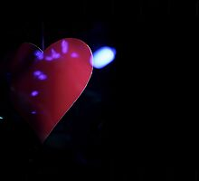 Saint Valentines day red love heart in darkness 35mm negative analog film photograph by edwardolive