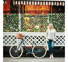 Young blonde woman with a vintage bicycle Photographic Print