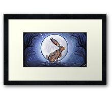 Hare under the moon Framed Print