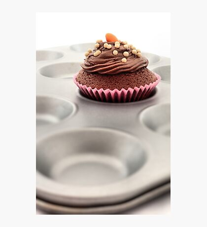 Single fairy cake on a baking tray. Photographic Print